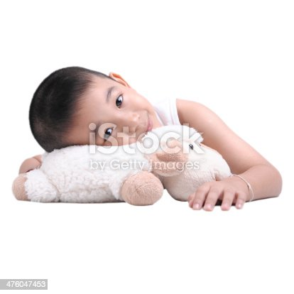 istock Adorable little boy resting in the bed closeup 476047453