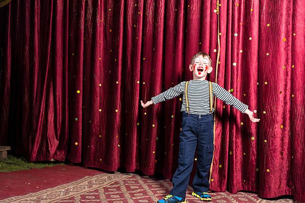 adorable little boy singing on stage during a play - acteur stockfoto's en -beelden