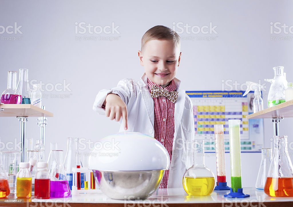 Adorable little boy watching reaction of reagent stock photo