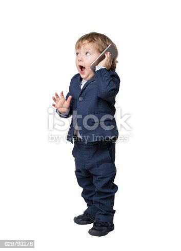 istock Adorable little child is talking on phone 629793278