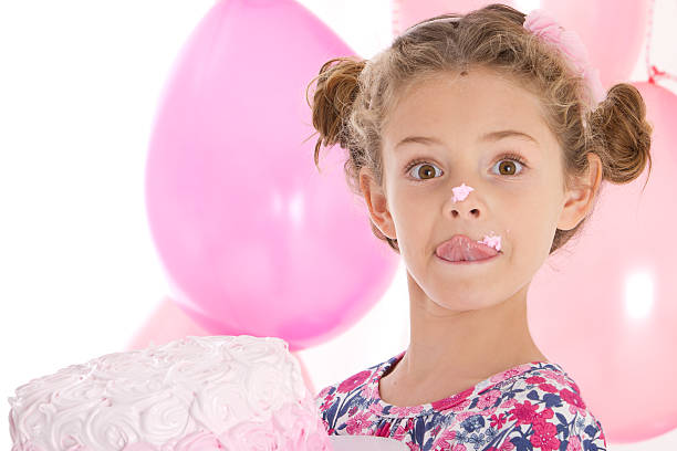 Adorable little girl at pink party stock photo