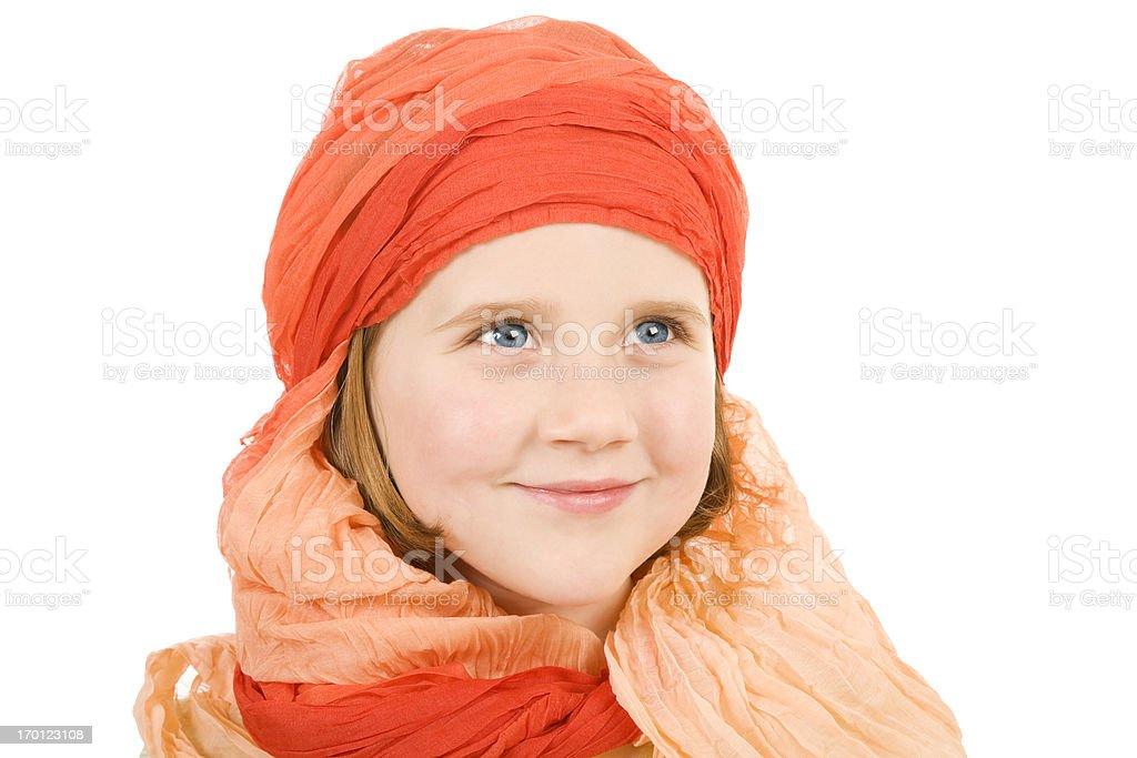 Adorable little girl blue eyes head scarf bright orange isolated stock photo