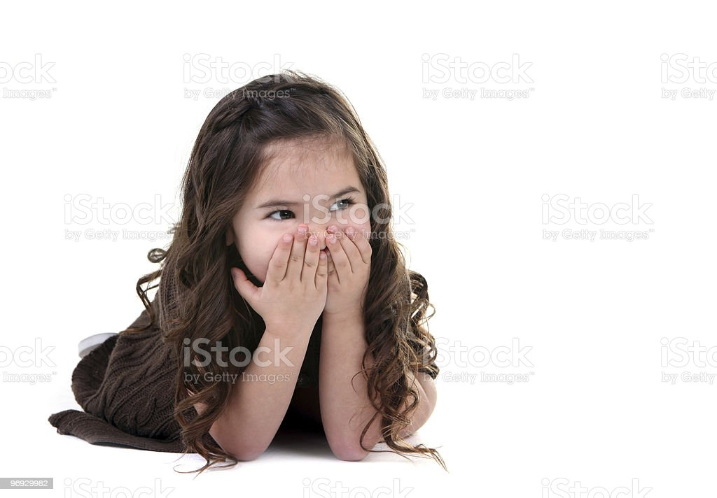 Adorable Little Girl Covering Her Mouth Laughing royalty-free stock photo