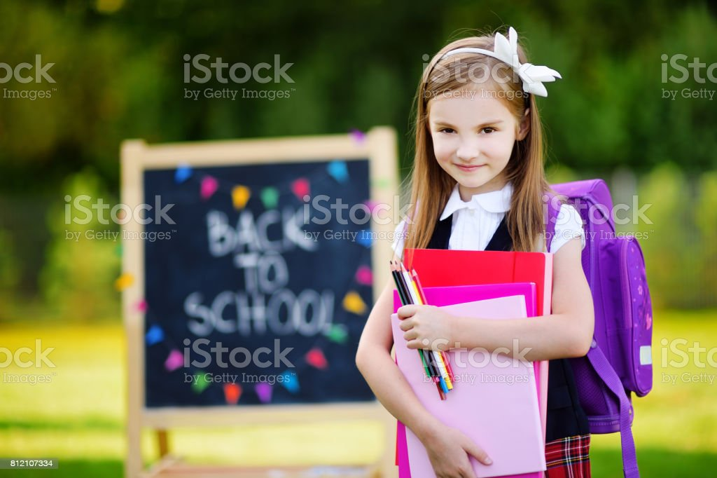 Adorable little girl feeling exited about going back to school stock photo