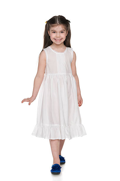 adorable little girl in a white dress - beyaz elbise stok fotoğraflar ve resimler