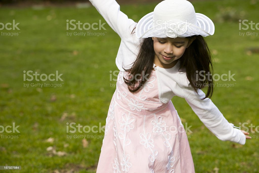 Adorable Little Girl in Easter Dress Playing Outside, Copy Space royalty-free stock photo