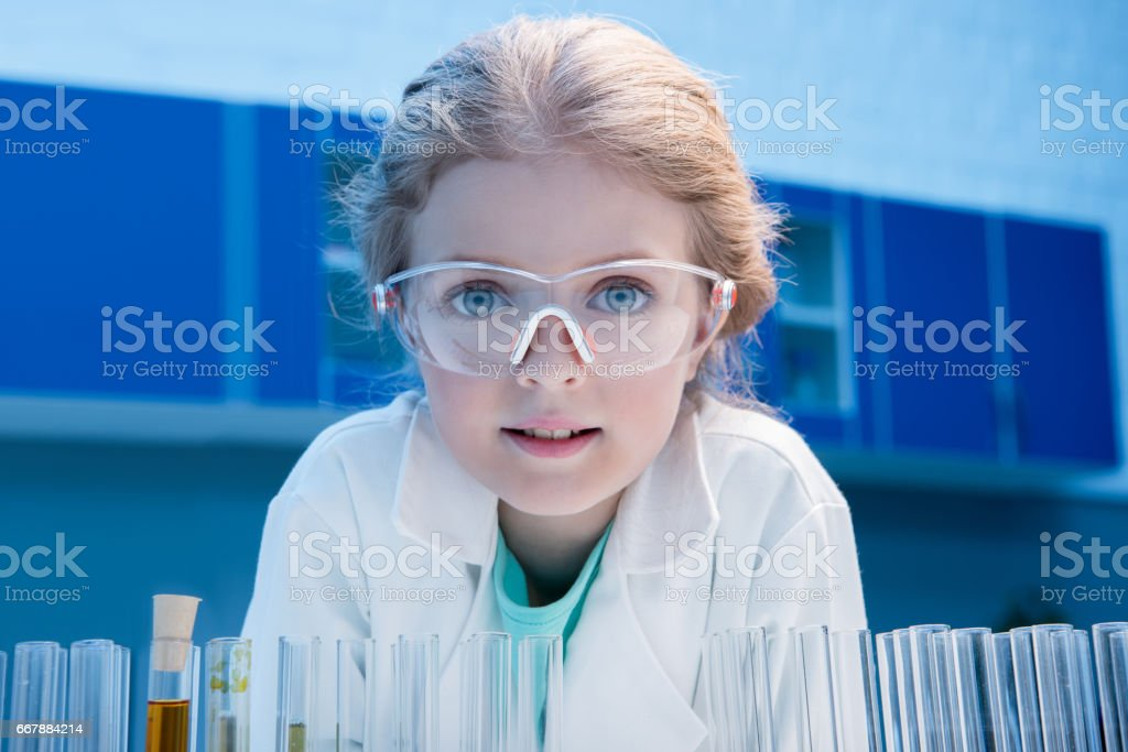 adorable little girl in goggles with reagents in tubes in laboratory royalty-free stock photo