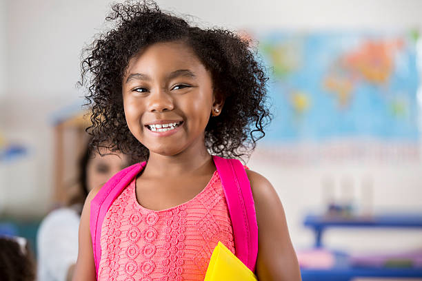 Adorable little girl in her classroom stock photo