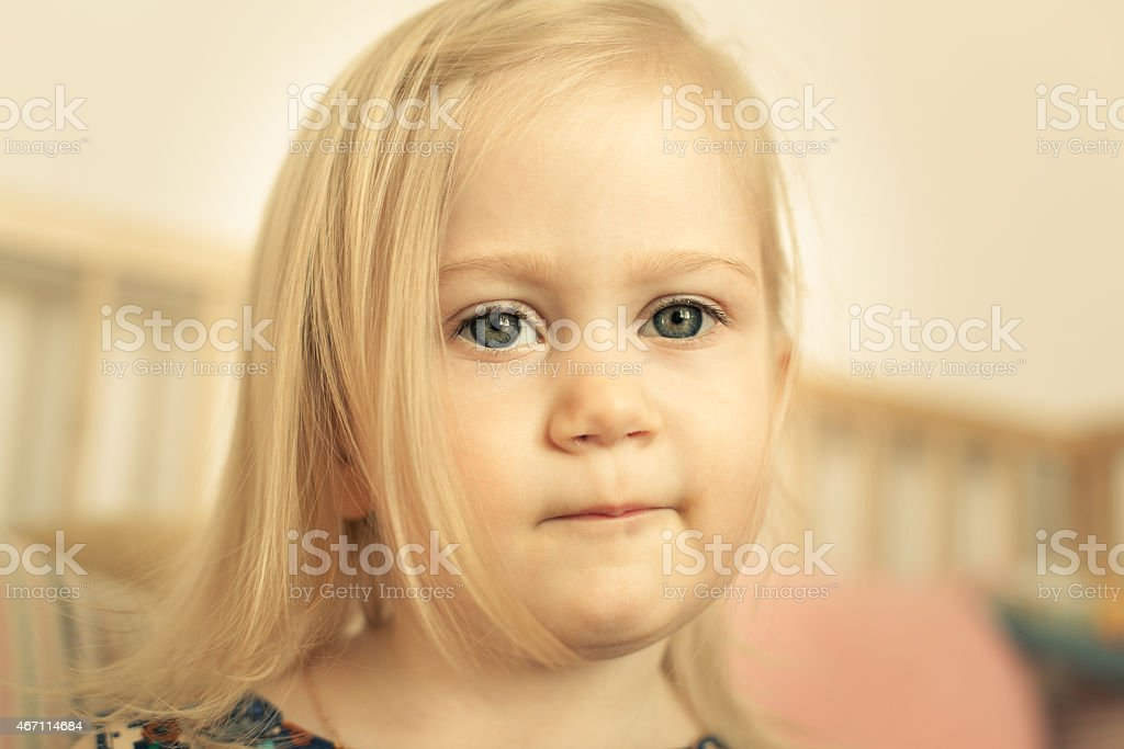 Adorable little girl in her room stock photo