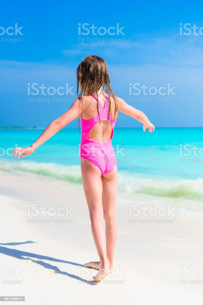 f3474c4e466c2 Adorable little girl in swimsuit on beach vacation - Stock image .