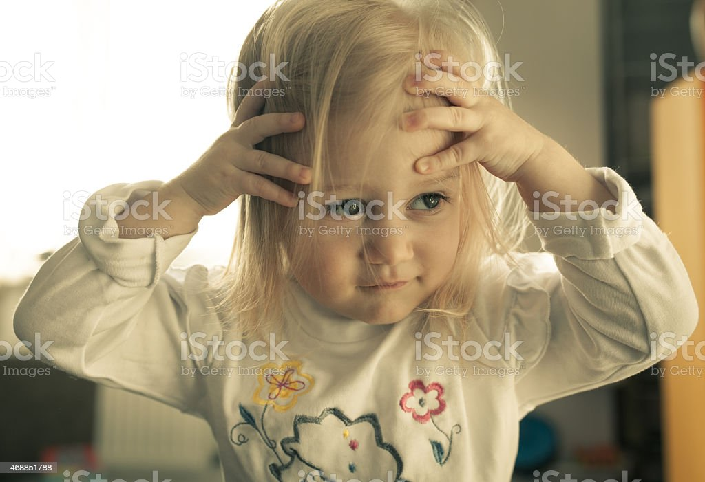 Adorable little girl looking away from the camera. stock photo