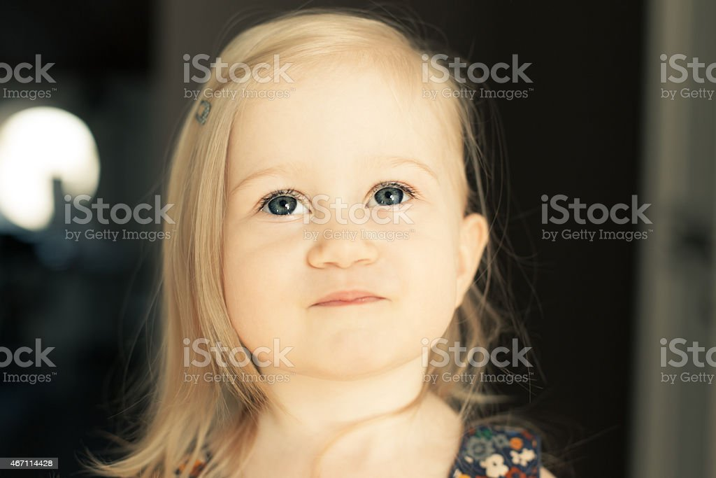 Adorable little girl looking up. stock photo