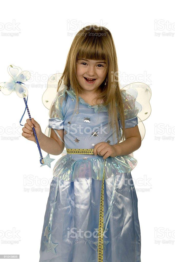 adorable little girl measuring waist royalty-free stock photo