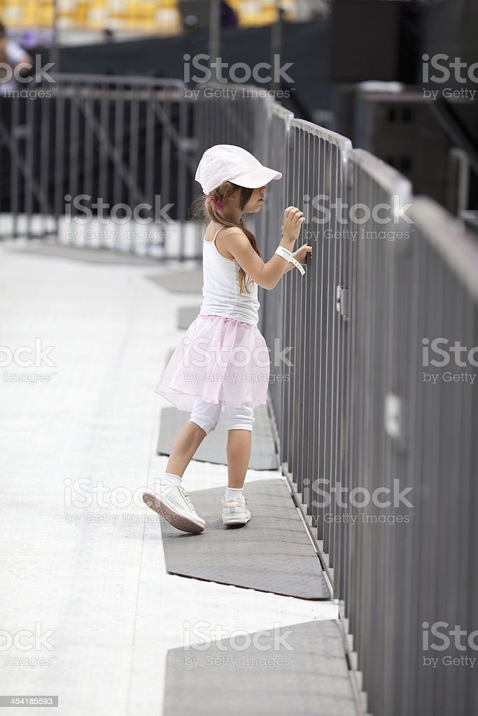 Adorable little girl on the stadium royalty-free stock photo