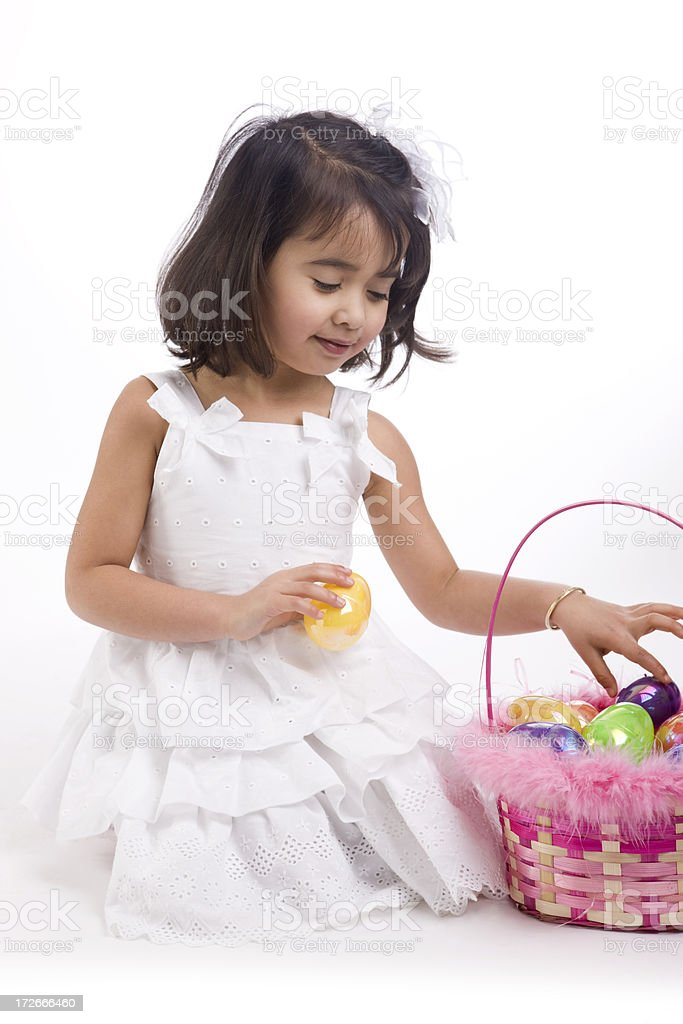 Adorable Little Girl on White with Basket of Easter Eggs royalty-free stock photo