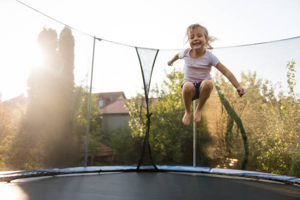 Adorable little girl playing outdoors stock photo