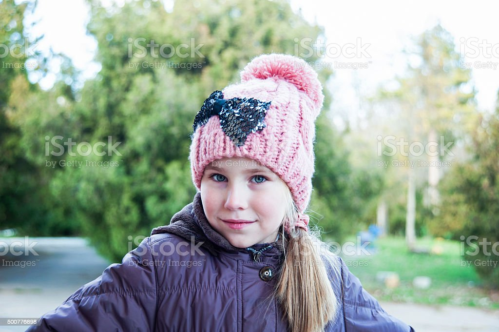 97071100d Adorable little girl posing. Wearing winter coat and hat. - Stock image .