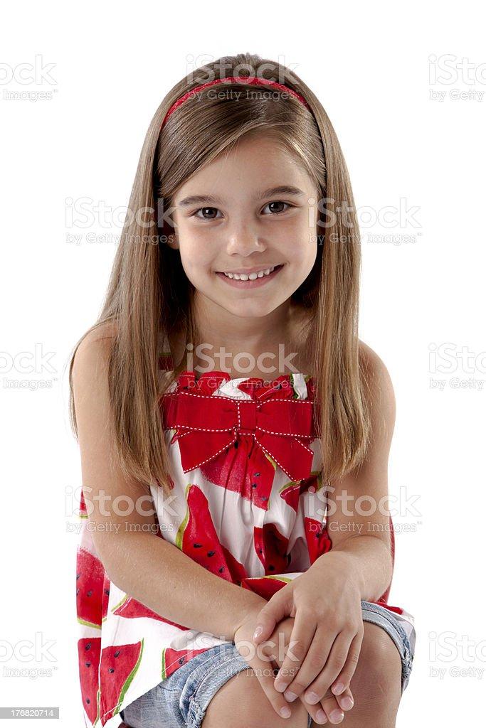 Adorable Little Girl Sits Politely stock photo