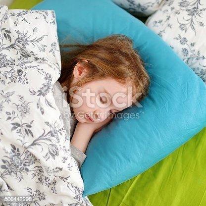 istock Adorable little girl sleeping 506442298