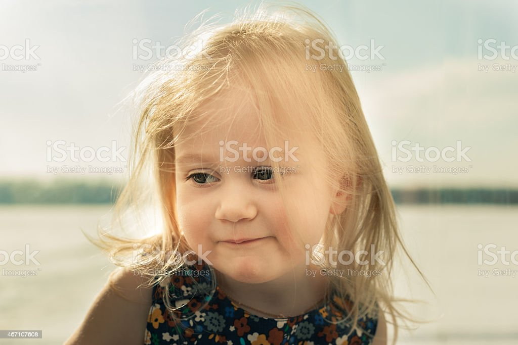 Adorable little girl smiling in front of the camera stock photo