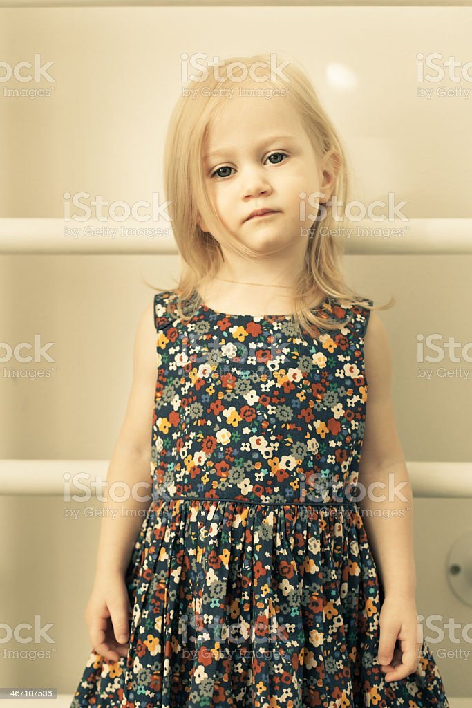 Adorable little girl standing still stock photo