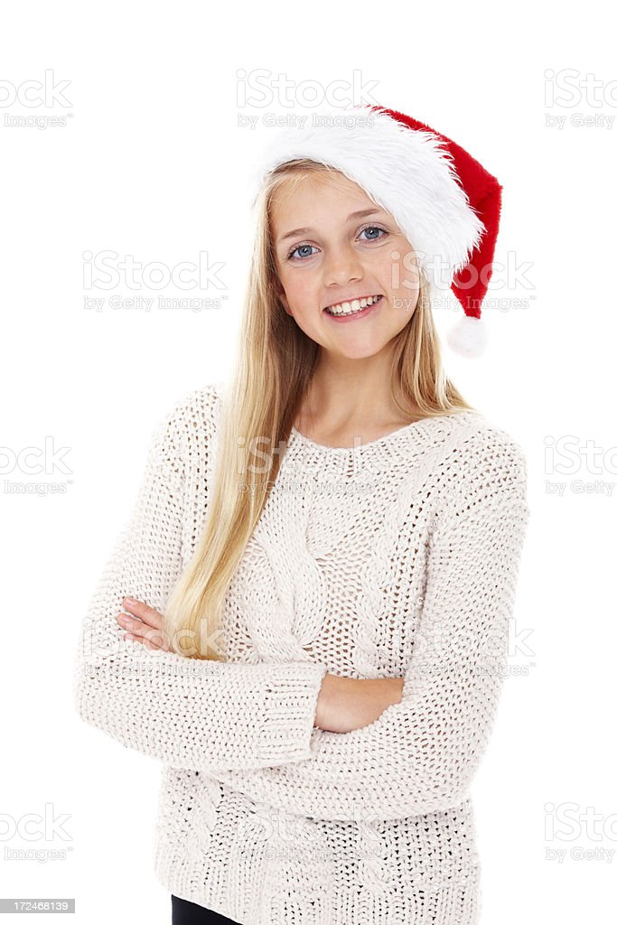 Adorable little girl wearing Santa hat standing on white royalty-free stock photo