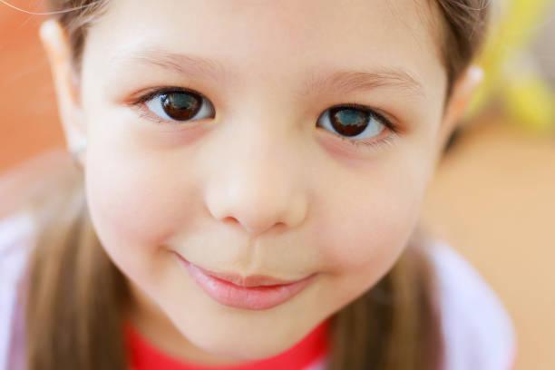 Adorable little girl with big eyes stock photo