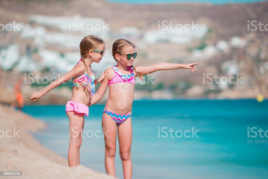 380330a4d0687 Adorable Little Girls Enjoy Summer Beach Vacation Stock Photo & More ...