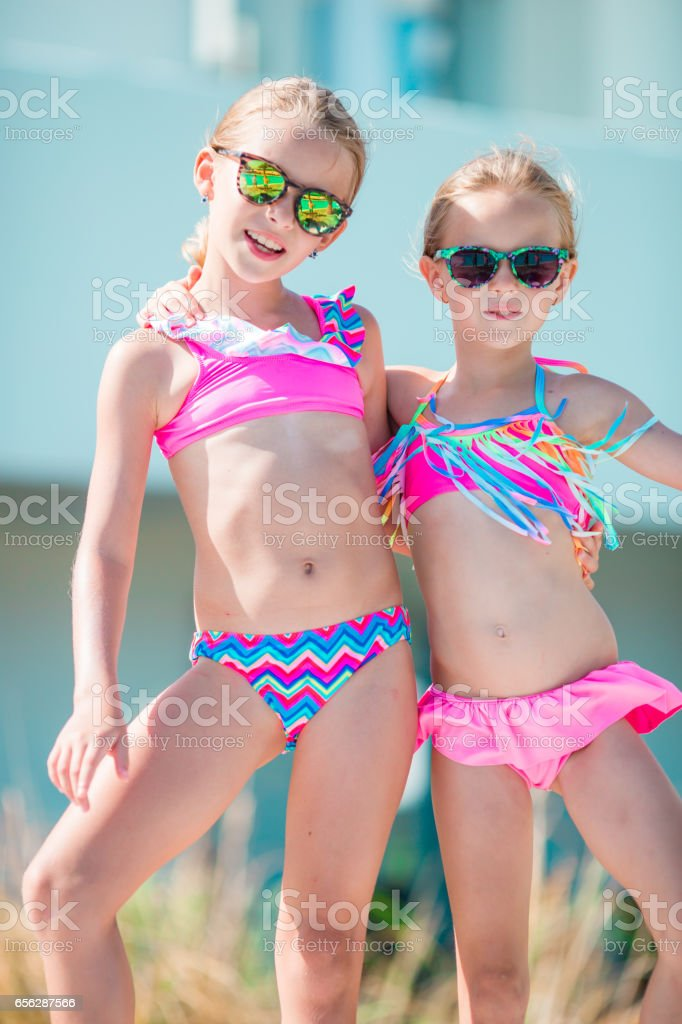 ef60643e166a9 Adorable little girls enjoy their summer vacation in Greece - Stock image .