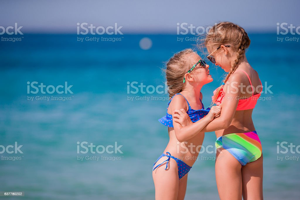 83dd2eb3427ac Adorable little girls having fun during beach vacation - Stock image .