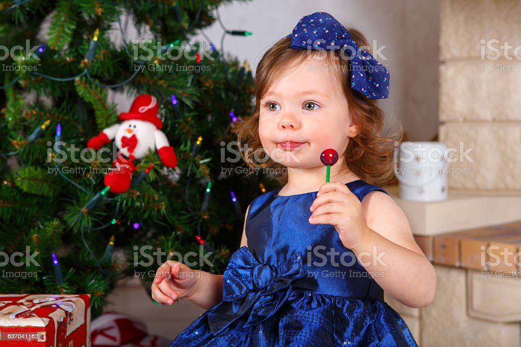 29755de5 Adorable little kid girl celebrating Christmas holiday at home - Stock  image .