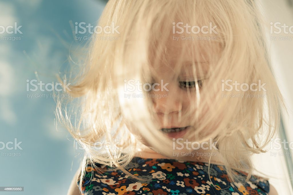 Adorable little looking down stock photo