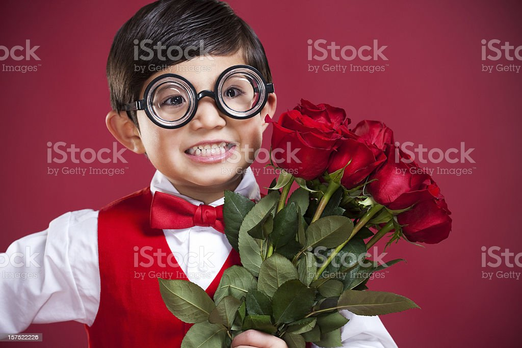 Adorable Little Nerd Boy with Valentines Roses, Copy Space royalty-free stock photo