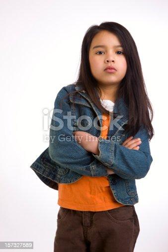 istock Adorable Mixed Asian Hispanic Girl Crossing Arms Looking Tough 157327589