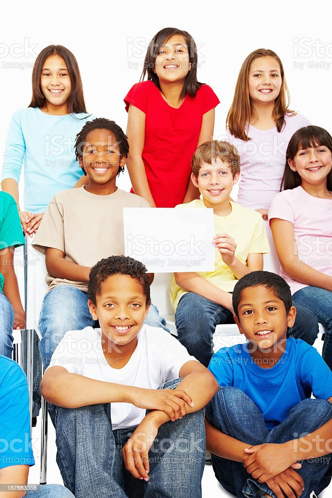 Adorable multi ethnic kids holding a blank piece of paper royalty-free stock photo