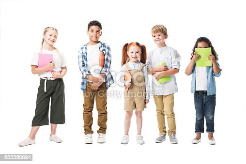 istock adorable multiethnic children holding textbooks and smiling at camera isolated on white 833380694