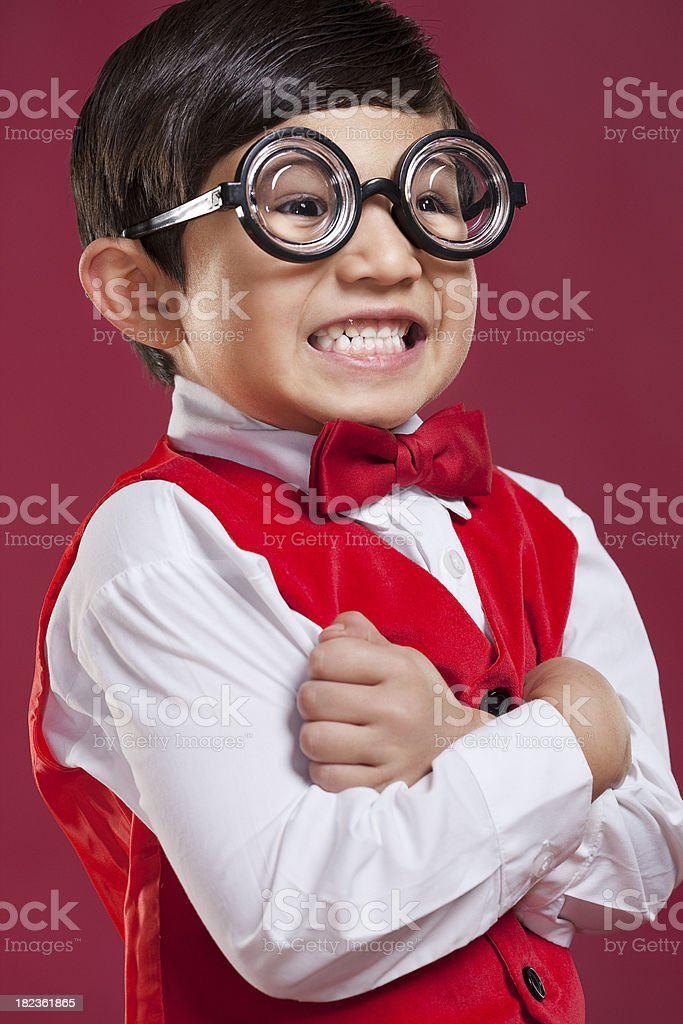 Adorable Nerdy Little Boy in Red Vest and Bow Tie royalty-free stock photo