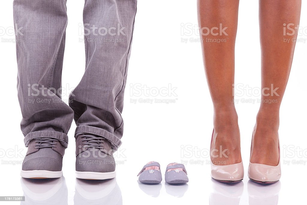 Adorable pregnancy announcement photo using empty shoes stock photo