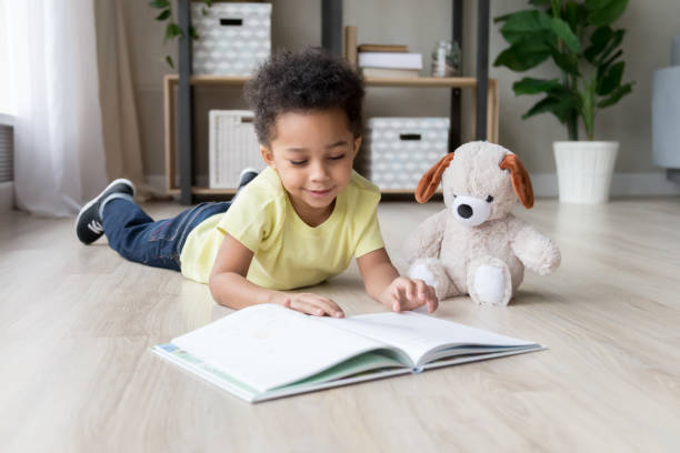 Adorable preschooler mixed race child boy reading book at home picture id1147395698?b=1&k=6&m=1147395698&s=612x612&w=0&h=kcgypdhsvgjvxsdj5zkdkhoiry t hjsu8cw8lvlxta=