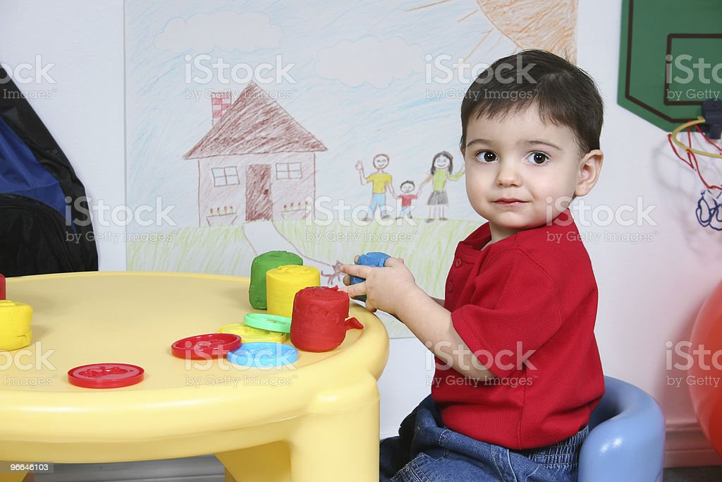 Adorable Preschooler Playing with Colorful Dough royalty-free stock photo