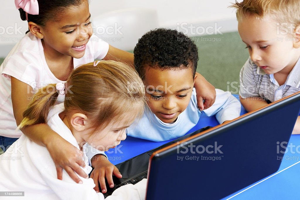 Adorable preschoolers using laptop computer royalty-free stock photo