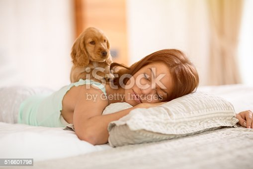istock Adorable puppy wake young girl in the morning 516601798