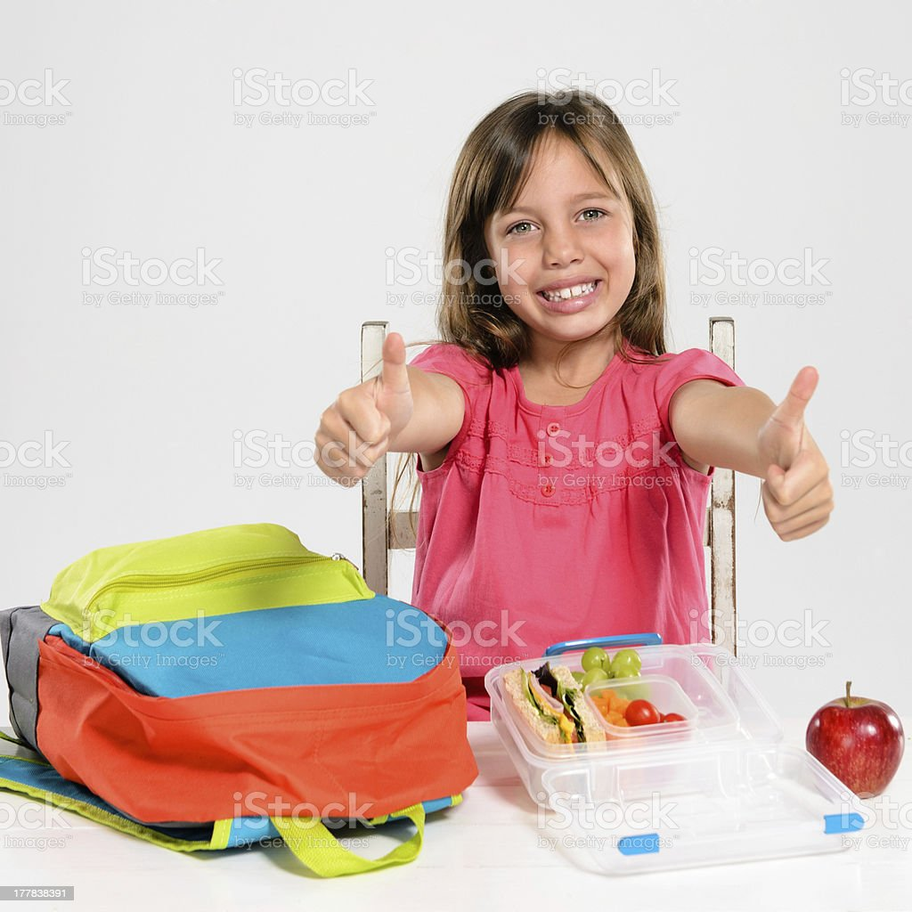 Adorable school girl with healthy lunch royalty-free stock photo