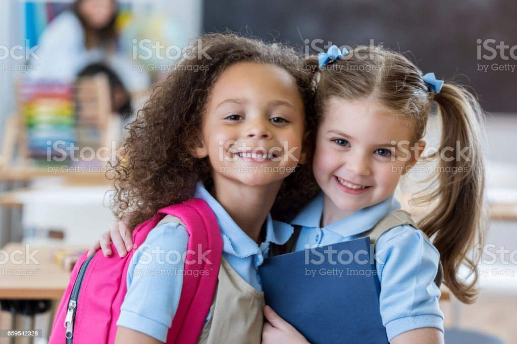 Adorable schoolgirls in class stock photo