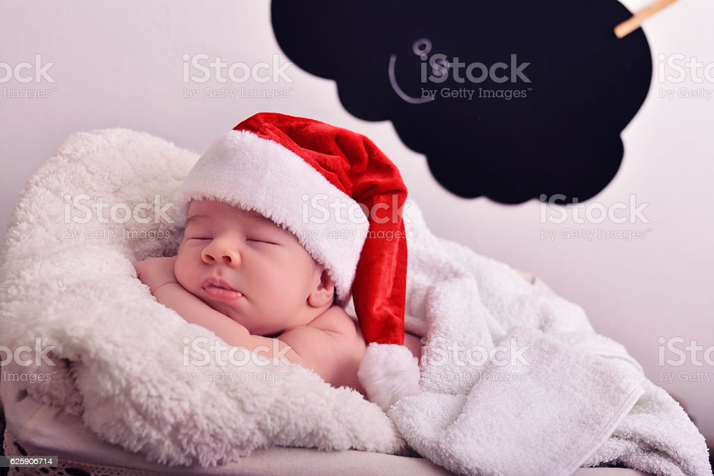 Adorable sleeping newborn baby wearing Santa Claus hat royalty-free stock  photo 40e83846bbc7