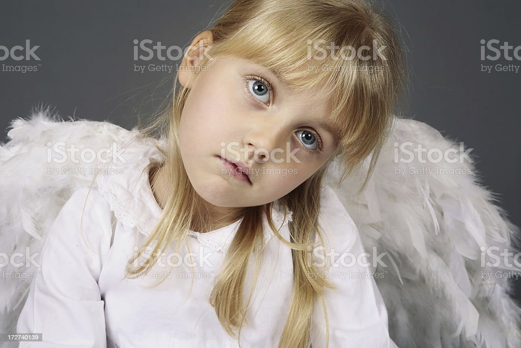 adorable sleepy angel girl royalty-free stock photo