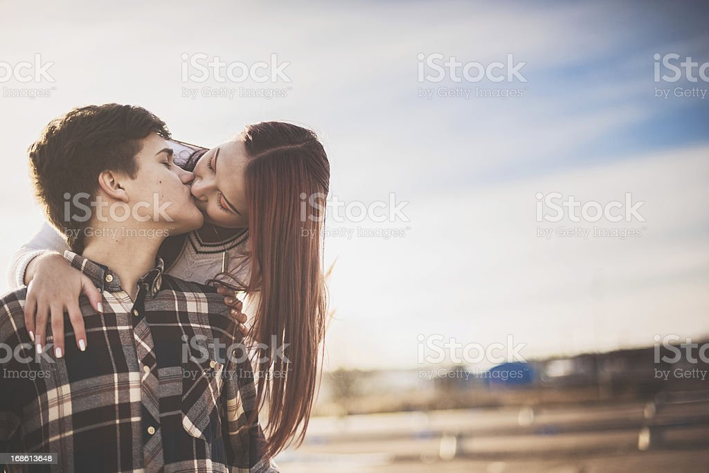 Adorable teenagers in love stock photo