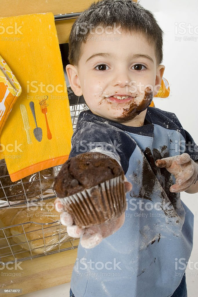 Adorable Toddler Boy Sharing Chocolate Muffin royalty-free stock photo
