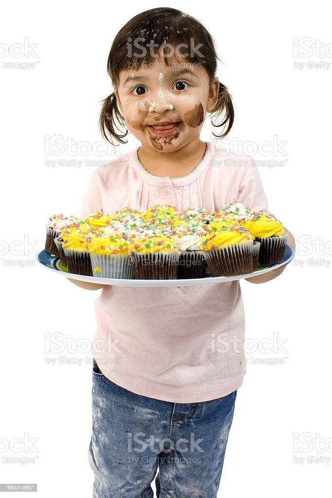 Adorable Toddler Girl with Cupcakes royalty-free stock photo
