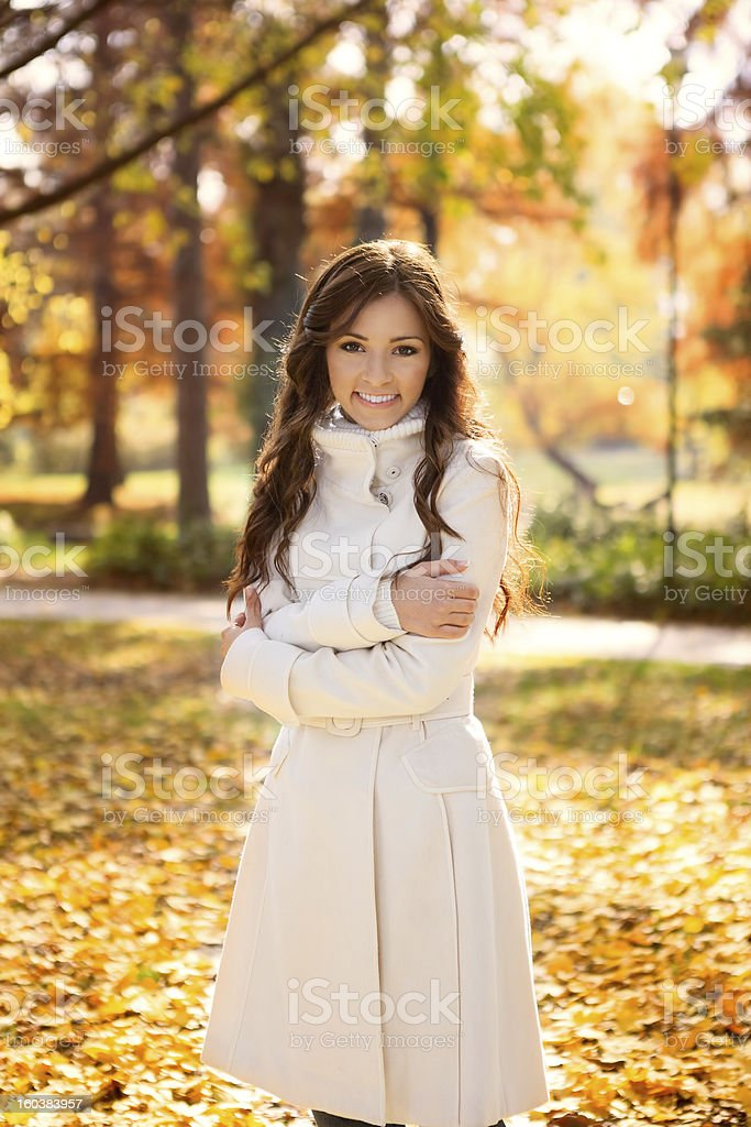 adorable woman in autumn park royalty-free stock photo